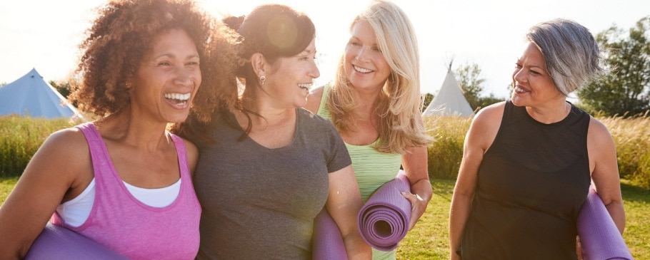 Women over 45 with yoga mats